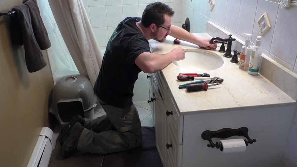 tim fixing sink